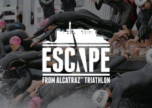 Escape From Alcatraz logo over photo of people diving into water