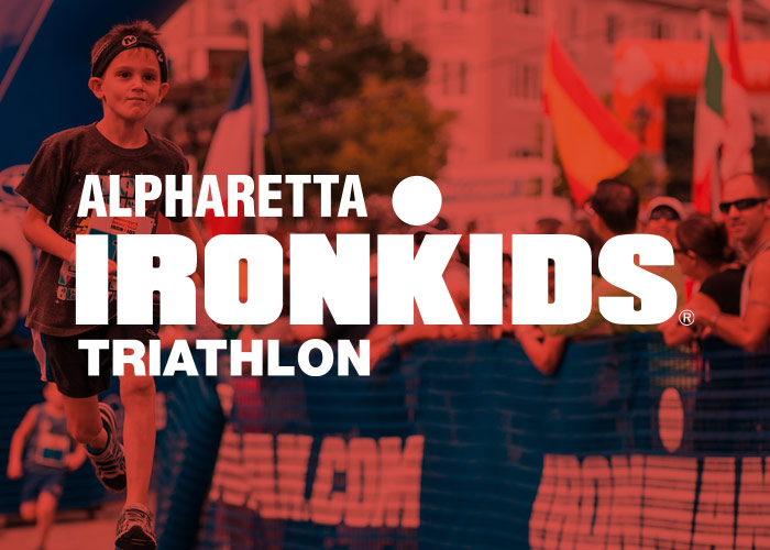 Ironkids Aplharatta - White Uppercase Type Logo Over Red-tinted Event Photo Of Kid Running